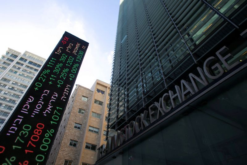 FILE PHOTO: An electronic board displaying market data is seen at the entrance of the Tel Aviv Stock Exchange, in Tel Aviv, Israel January 29, 2017. REUTERS/Baz Ratner/File Photo