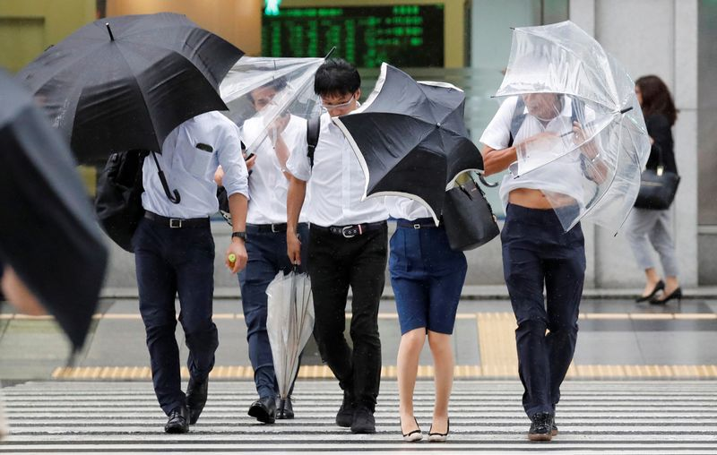 Passersby using umbrellas struggle against strong wind and rain caused by Typhoon Jebi, in Tokyo, Japan,  September 4, 2018.   REUTERS/Toru Hanai