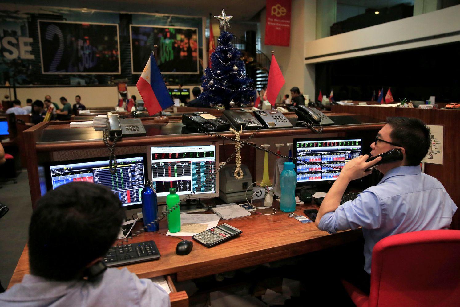 Stocks Drop Amid EM Turmoil; Dollar Holds Gains: Markets Wrap