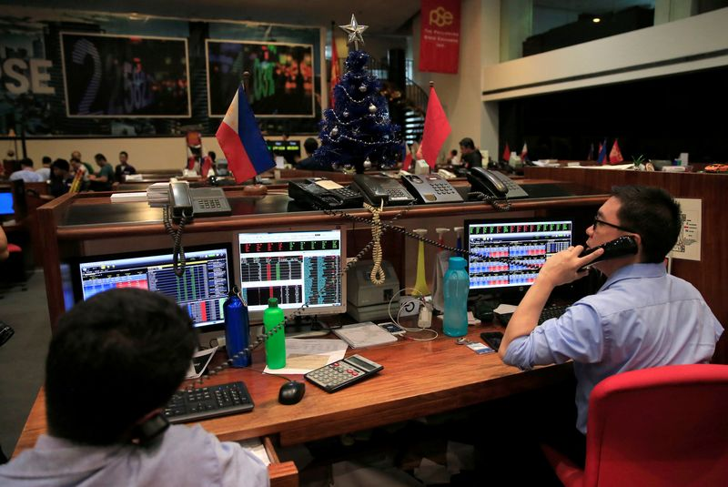 Traders begin work on the first day of 2018 trading at the Philippine Stocks Exchange (PSE), as the benchmark index hits a new record high, in the financial district of Makati city, Metro Manila, Philippines January 3, 2018.        REUTERS/Romeo Ranoco