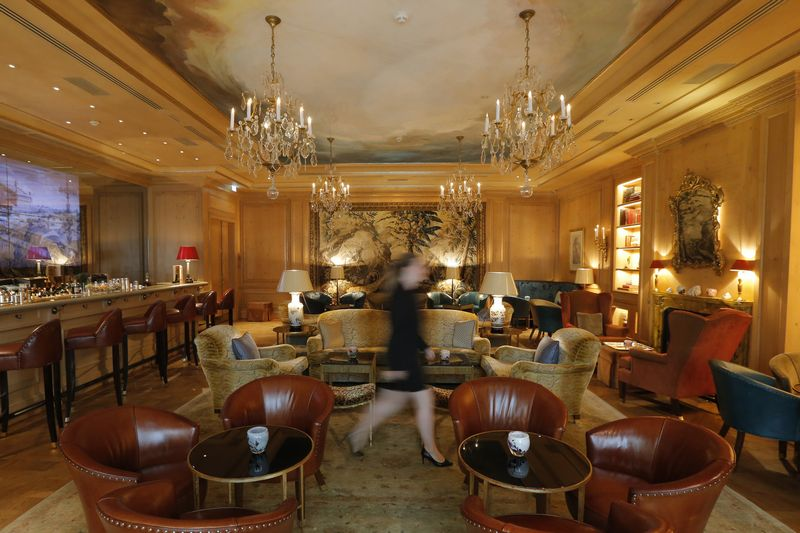 An employee walks through the bar of the luxury hotel Le Bristol, in Paris, France July 27, 2015. Picture taken July 27, 2015.  REUTERS/Stephane Mahe