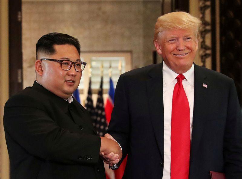 """JAV prezidentas Donaldas Trumpas ir  Šiaurės Korėjos lyderis Kim Jong Unas.  Jonathano Ernsto (""""Reuters"""" / """"Scanpix"""") nuotr."""