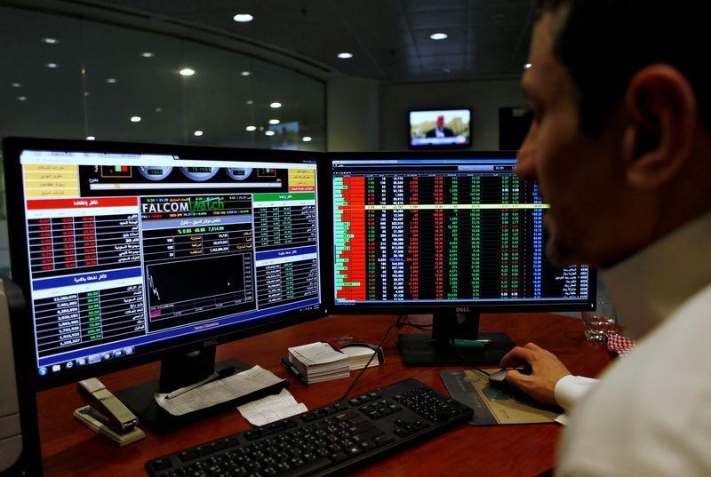 FILE PHOTO: A Saudi trader observes the stock market on monitors at Falcom stock exchange agency in Riyadh, Saudi Arabia February 7, 2018. REUTERS/Faisal Al Nasser/File Photo