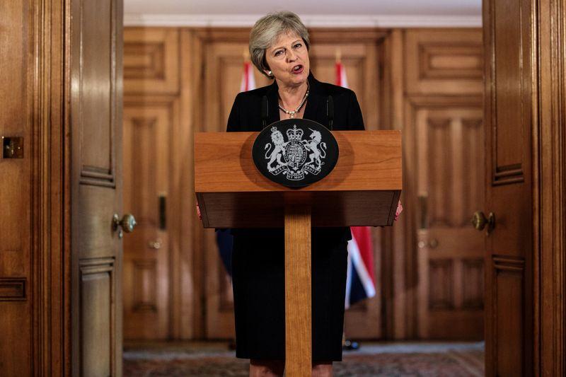 "JK premjerė Theresa May. Jacko Tayloro (""Reuters"" / ""Scanpix"") nuotr."