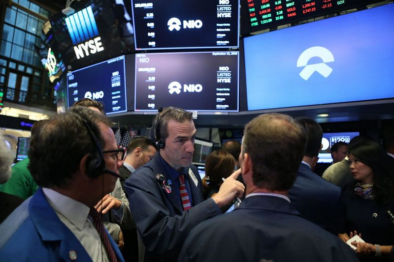 (180912) -- NEW YORK, Sept. 12, 2018 (Xinhua) -- Traders work at the New York Stock Exchange in New York, the United States, on Sept. 12, 2018. NIO Inc., a Chinese electric vehicle start-up, rang the New York Stock Exchange (NYSE) opening bell on Wednesday in celebration of its initial public offering (IPO). The company, trading under the ticker symbol of NIO, announced the pricing of its IPO of 160,000,000 American depository shares (ADSs), at 6.26 U.S. dollars per ADS for a total offering size of approximately 1 billion dollars, assuming the underwriters do not exercise their option to purchase additional ADSs. Founded in 2014, NIO, dubbed as China's Tesla, is a pioneer in China's premium electric vehicle market. (Xinhua/Qin Lang) - Qin Lang -//CHINENOUVELLE_CnynysE000082_20180913_TPPFN0A001/Credit:CHINE NOUVELLE/SIPA/1809130915