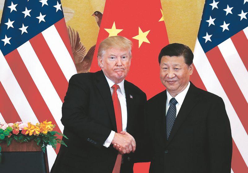 """JAV pareigūnai nevyks į Kinijoje organizuojamą parodą. Damiro Sagoljo (""""Reuters"""" / """"Scanpix"""") nuotr."""