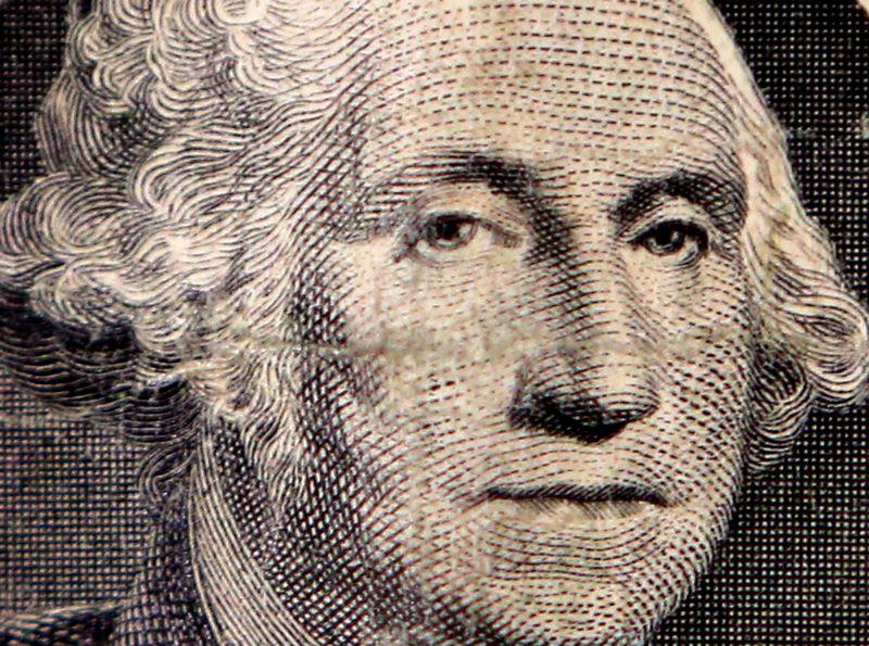 """JAV prezidento George Washingtono atvaizdas ant dolerio kupiūros. Chriso Helgreno (""""Reuters""""/""""Scanpix"""") nuotr."""