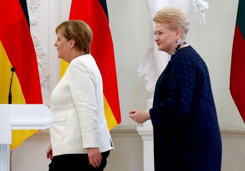 Angela Merkel, Dalia Grybauskaitė. Ints Kalnins (Reuters / Scanpix) nuotr.