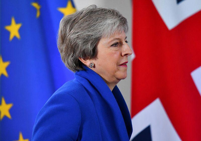 """JK premjerės šansai gauti pritarimą """"Brexit"""" sutarčiai Bendruomenių rūmuose nėra dideli. Dylano Martinezo (""""Reuters"""" / """"Scanpix"""") nuotr."""