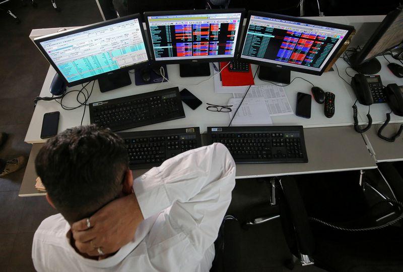 """Investuotojai gyvena išaugusio neapibrėžtumo sąlygomis. Francio Mascarenho (""""Reuters"""" / """"Scanpix"""") nuotr."""
