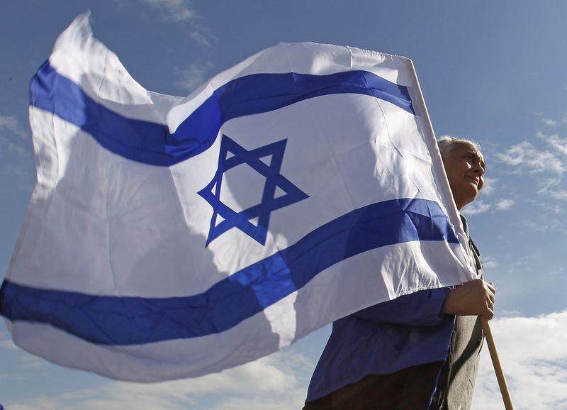"""Vienas iš dvidešimties europiečių nėra girdėjęs apie Holokaustą, nors pasaulyje vis dar gyvena tūkstančiai žydų, kuriems pavyko išgyventi masinio tautos naikinimo siaubą. Peterio Andrewso """"Reuters"""" / """"Scanpix"""" nuotr."""