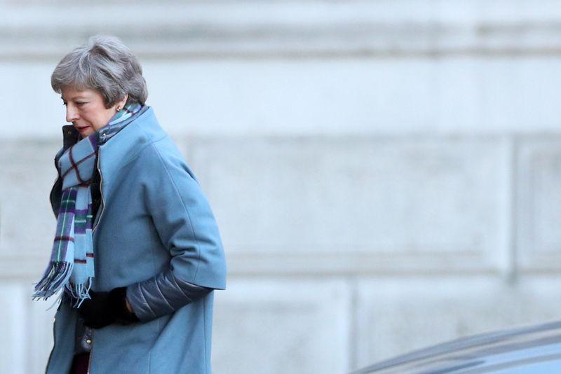 """Antradienį JK parlamentarai balsuos ir dėl Theresos May, JK premjerės, siūlomo """"plano B"""". Hannah Mckay (""""Reuters"""" / """"Scanpix"""") nuotr."""