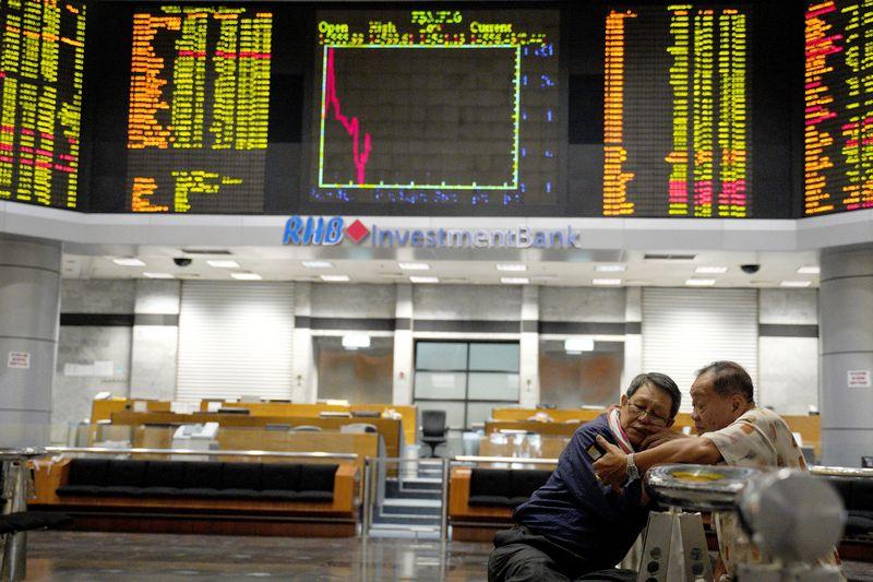 """""""Wealthtech"""" žada panaikinti patekimo į finansų rinkas barjerus. Yam G-Juno (AP / """"Scanpix"""") nuotr."""