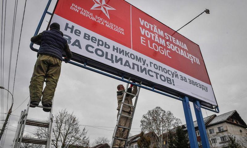 """Moldovoje ruošiamasi rinkimams. Danielo Mihailescu (""""AFP"""" / """"Scanpix"""") nuotr."""
