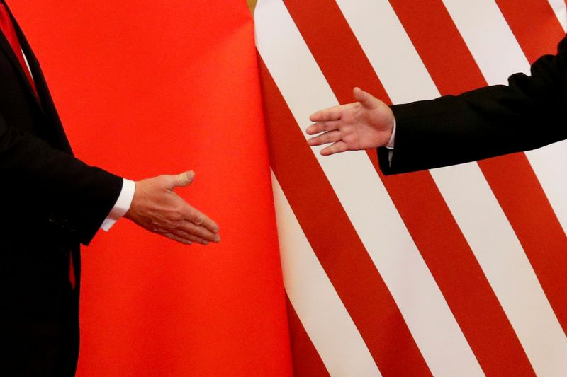 """Neoficialių šaltinių duomenimis, prekybos derybos tarp Kinijos ir JAV vyksta teigiama linkme. Damiro Sagoljo (""""Reuters"""" / """"Scanpix"""") nuotr."""