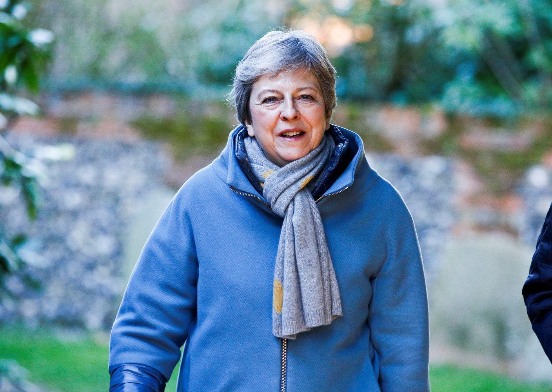"""Po konstitucinio chaoso Th. May neatsisako planų dėl savo """"Brexit""""strategijos"""