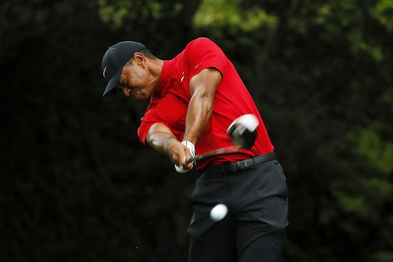 T. Woodsas su trenksmu grįžo į golfo olimpą