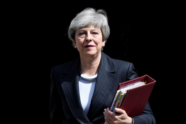 """Th. May atnaujintas """"Brexit"""" planas ir vėl sutiktas kritiškai"""