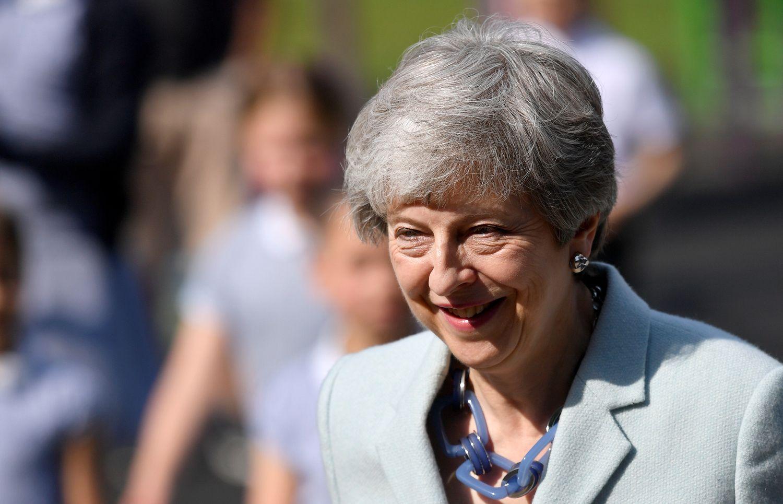 """Didėja spaudimas Th. May, atideda """"Brexit"""" balsavimą"""