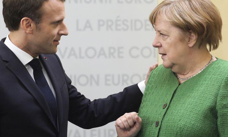 """Emmanuelis Macronas, Prancūzijos prezidentas, ir Angela Merkel, Vokietijos kanclerė, Europos Komisijos poste nori matyti skirtingus asmenis. Ludovico Marino (""""REUTERS"""" / """"SCANPIX"""") nuotr."""