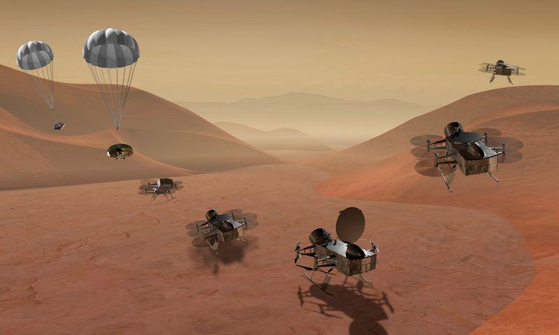 """NASA išplatino vizualizaciją, kaip ant Titano paviršiaus turėtų nusileisti ir nuo jo pakilti """"Dragonfly"""" kosminis zondas. NASA / """"Scanpix"""" nuotr."""