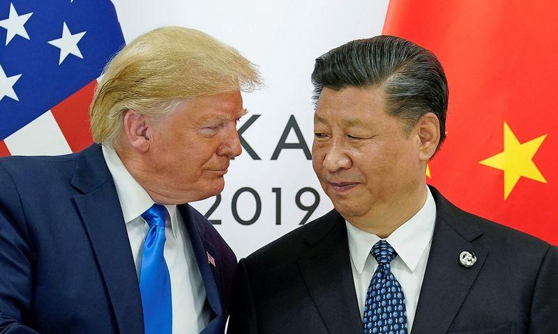 """Donaldo Trumpo, JAV prezidento, ir Xi Jinpingo, Kinijos vadovo, suderėtos prekybos paliaubos truko neilgai. Kevino Lamarque (""""Reuters"""" / """"Scanpix"""") nuotr."""