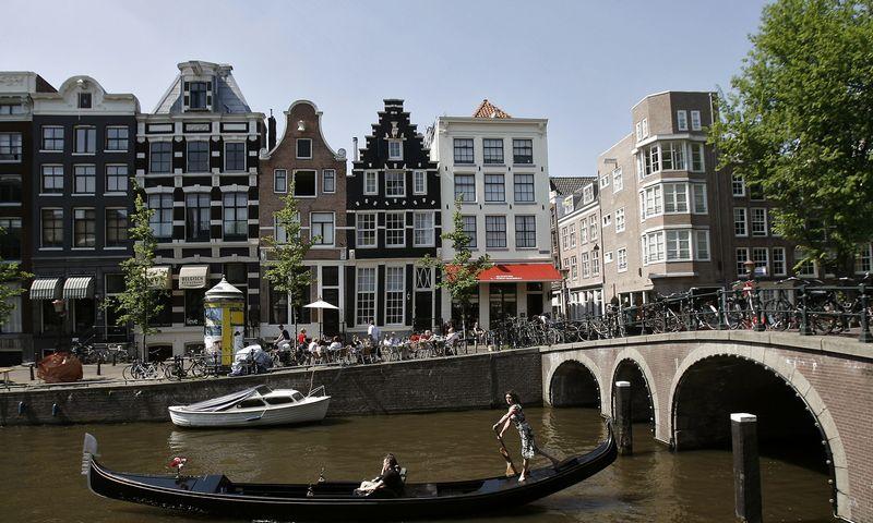 "Amsterdamą per metus aplanko apie 20 mln. turistų. Robin van Lonkhuijsen (""United Photos""/""Scanpix"") nuotr."