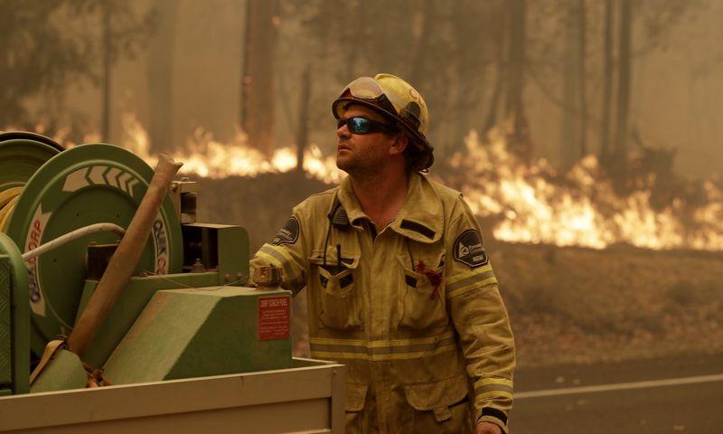 "Gaisrai Australijoje. Ricko Rycrofto (AFP / ""Scanpix"") nuotr."