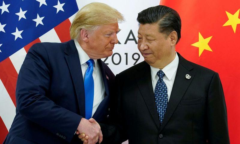 """JAV ir Kinija pagaliau baigia pirmo etapo prekybos derybas. KEVINO LAMARQUE (""""Reuters"""" / """"Scanpix"""") nuotr."""