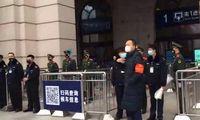 Stabdydama naujo viruso plitimą Kinija uždarė du miestus