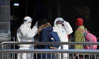 Kinijoje daugėjant viruso aukų, įvedama naujų susisiekimo apribojimų