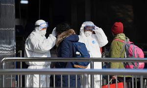 Dėl viruso protrūkio susisiekimas apribotasdevintame Kinijos mieste