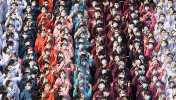 Kinija teigia, kad koronaviruso pandemija gali būti įveikta iki birželio pabaigos