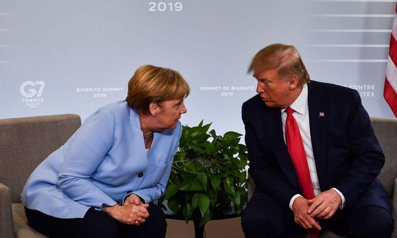"""Angela Merkel, Vokietijos kanclerė, ir Donaldas Trumpas, JAV prezidentas. Nicholas Kammo (""""AFP"""" / """"Scanpix"""") nuotr."""