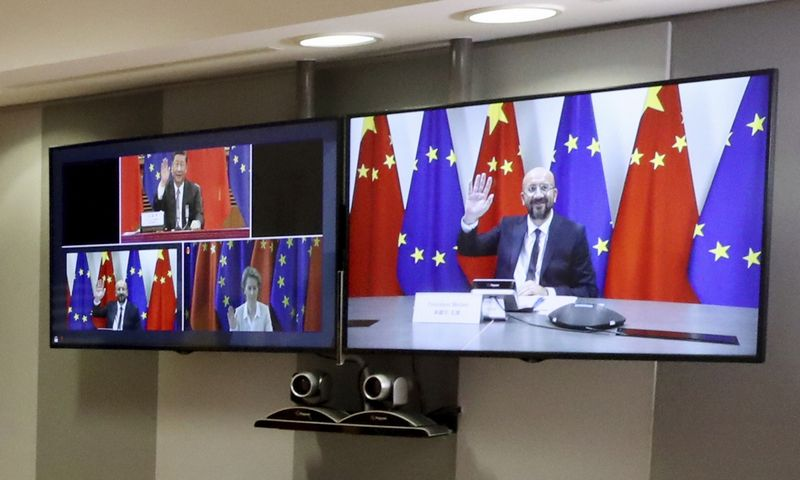 European Council President Charles Michel, right screen, waves to Chinese President Xi Jinping, left screen top, during an EU-China summit, in video conference format, at the European Council in Brussels, Monday, June 22, 2020. Top European Union officials are holding talks Monday with Chinese President Xi Jinping and Premier Li Keqiang at a time of rising tensions between two major trading partners over the fallout from the coronavirus crisis and Beijing's increasing control over Hong Kong. (Yves Herman, Pool Photo via AP)