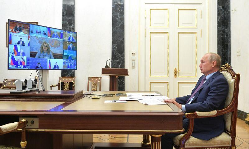 """Alexei Druzhinin (Rusijos prezidento spaudos ir informacijos biuro / TASS / """"Scanpix"""") nuotr."""