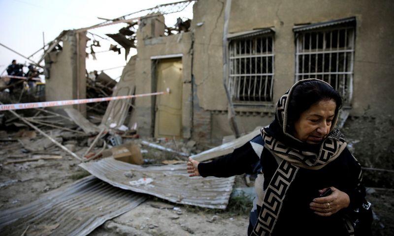 """Per raketų smūgį gyvenamųjų rajone buvo sugriautos kelios eilės namų. Umito Bektašo (""""Reuters"""" /""""Scanpix"""") nuotr."""