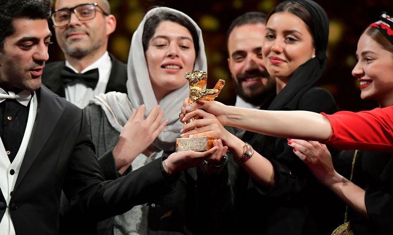 """Filmo """"Blogio nėra"""" kūrybinė komanda Berlyno kino festivalyje.  Tobiaso Schwarzo (AFP / """"Scanpix"""") nuotr."""
