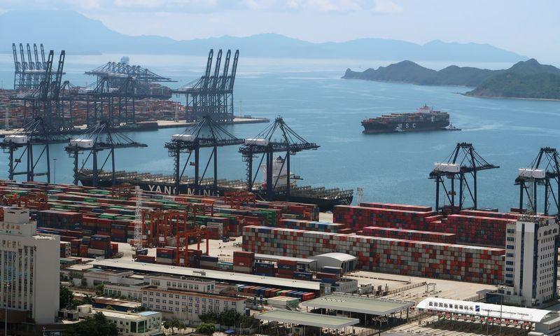 """Karantinas 13 mln. TEU per metus perkraunančiame Jantiano uoste sukels poveikį visame pasaulyje.  """"Reuters"""" / """"Scanpix"""" nuotr."""