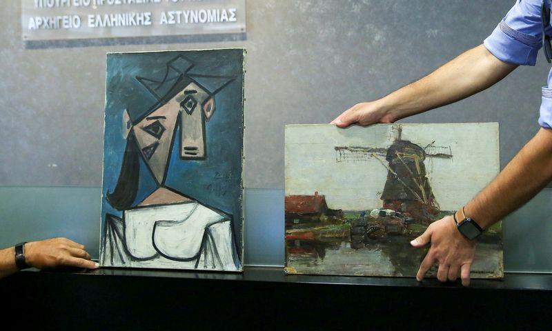 "Pablo Picasso ""Moters galva"" ir Pieto Mondriano ""Malūnas"". Costas Baltas (""Reuters""/""Scanpix"") nuotr."