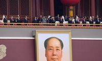 """Kinijos komunistai švenčia partijos šimtmetį ir šlovina sukurtą """"naują pasaulį"""""""