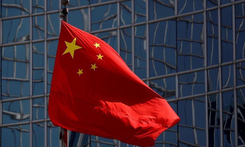 """Kinijos vėliava. Thomaso Peterio/""""Reuters""""/""""Scanpix"""" nuotr."""